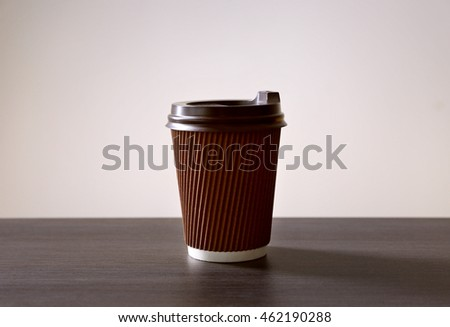Paper cup of coffee on light background #462190288