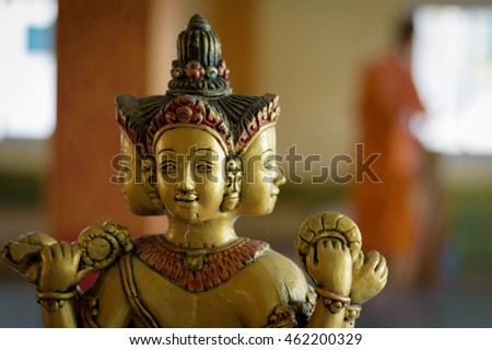 Hindu god Brahma gold shabby old statue in Thailand. Beautiful Indian religion traditional lord sculpture with for faces in a shrine #462200329