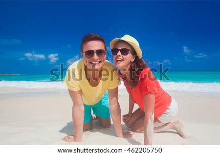 Couple in bright clothes having fun at tropical beach #462205750