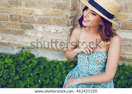 Sunny lifestyle fashion portrait of young stylish hipster woman walking on the street, wearing trendy outfit, straw hat, travel with backpack. #462425320