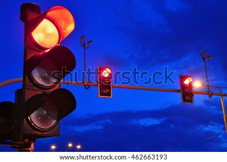 Traffic lights over sky after sunset