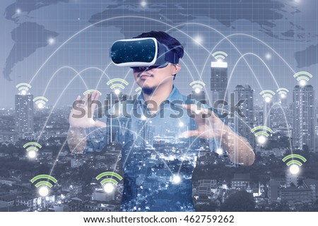 Double exposure Asian Man wearing virtual reality with Network connection line between building of cityscape background, business technology concept #462759262