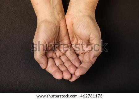 Hands of elderly woman on black background. Toned. #462761173