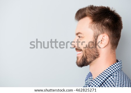 Side view of young happy smiling bearded man #462825271