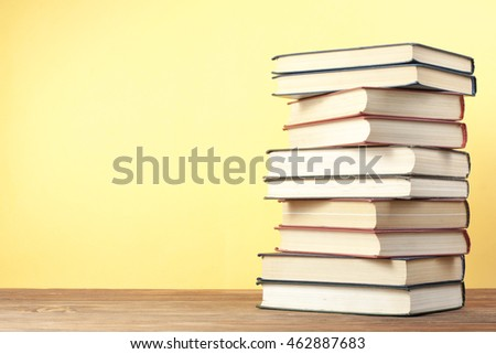 Stack of colorful books. Education background. Back to school. Copy space for text. #462887683