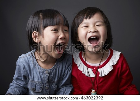 Two Asian Chinese child,Sisters and friends,playing in studio