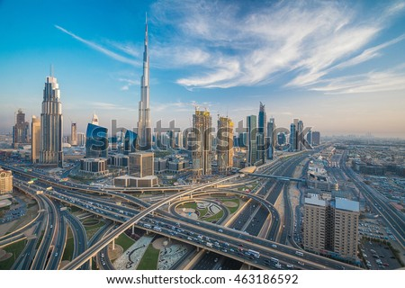 Dubai skyline with beautiful city close to it's busiest highway on traffic Royalty-Free Stock Photo #463186592