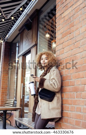 young pretty african american women drinking coffee outside in cafe, modern business woman lifestyle concept #463330676