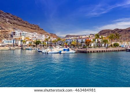 PUERTO DE MOGAN, GRAN CANARIA, SPAIN - APRIL 21, 2016: Marina of Puerto de Mogan, a small fishing port on Gran Canaria, Spain. Puerto de Mogan is called a Little Venice of the Canaries. #463484981