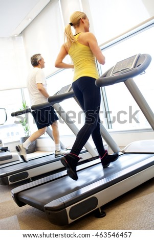 Man and woman exercising on treadmill #463546457