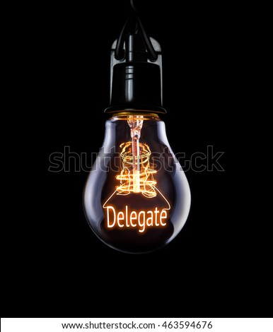 Hanging lightbulb with glowing Delegate concept. #463594676