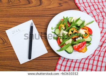 fresh vegetables salad and chees on wooden table. #463610312