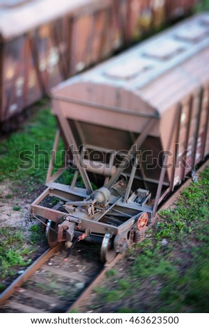Railway wagon for bulk material is at the station for loading or unloading. Tilt-shift lens. Blurry #463623500