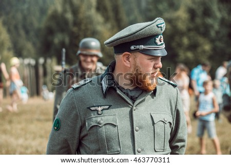"PERM, RUSSIA - JULY 30, 2016: ""Perm Regional Museum"", Historical reconstruction of second world war. The soldier in German uniform after a fight among the guests. #463770311"