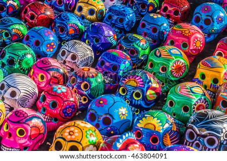Mexican Culture Celebration: Colorful (colourful) traditional Mexican/hispanic ceramic pottery Day of the Dead (Dia de los Muertos) skulls on display at a market in Mexico.