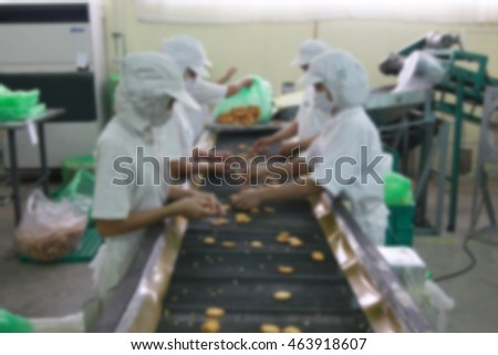 blur picture of worker in factory between hand made job process in food factory #463918607