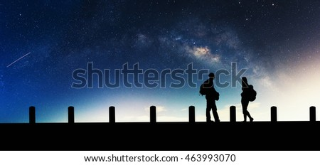 Galactic beautiful landscapes, travelers on the path that the Milky Way galaxy and the background light of the stars across the night sky. #463993070