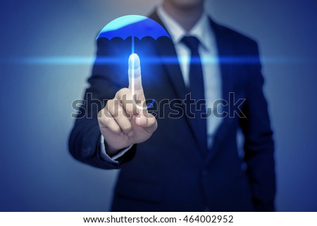 Close up of businessman touching umbrella icon, business security concept #464002952