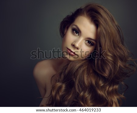 Portrait of a young beautiful brunette girl with long  hair #464019233