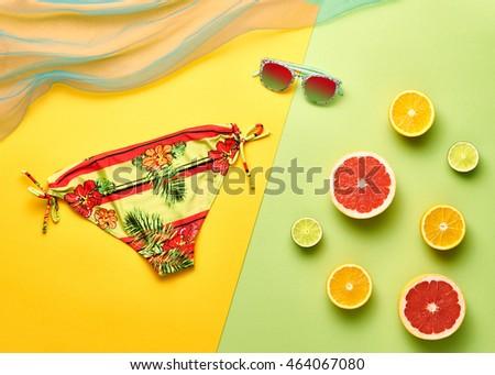Fashion. Tropical Fruit Citrus, Orange, Grapefruit Lime. Trendy clothes Accessories. Summer Beach Outfit. Stylish girl concept. Woman Bikini. Essentials creative art.Minimal  #464067080