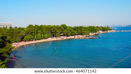 View from the pier on the beach with pines in Vodice, Croatia. #464071142
