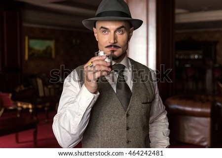 portrait of groom in hat with the glass of whiskey in the luxury apartments #464242481