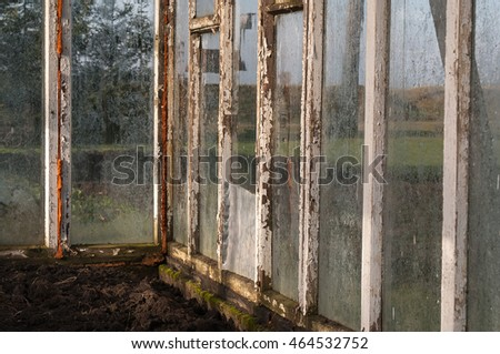 Old warm house with fogged, dirty glasses and wooden frames. #464532752