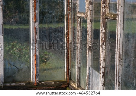 Old warm house with fogged, dirty glasses and wooden frames. #464532764