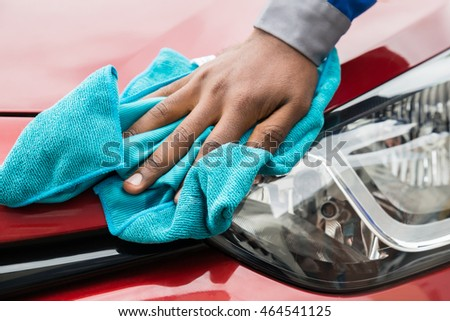 Close-up Of Male Worker Cleaning Car Headlight With Cloth #464541125