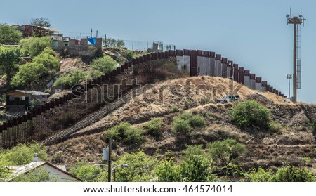 Border fence separating the United States and Mexico from Nogales, Arizona #464574014