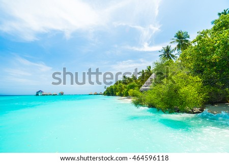 Beautiful tropical Maldives resort hotel and island with beach and sea on sky for holiday vacation background concept - Boost up color Processing #464596118