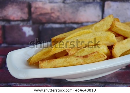 Fresh fried french fries with ketchup on wooden background   #464648810
