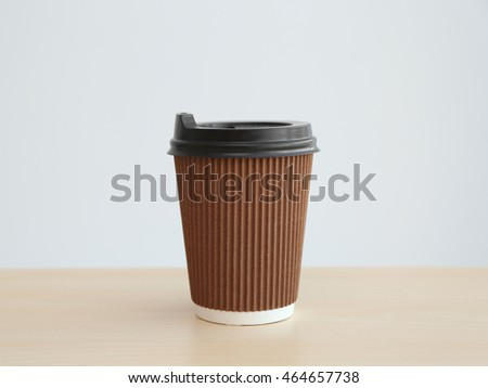 Paper cup of coffee on light background #464657738