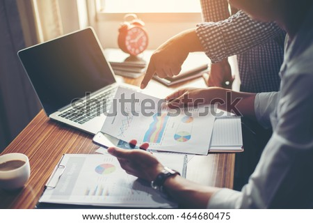 Financial,accounting,investment advisor consulting with her team at office. Royalty-Free Stock Photo #464680475