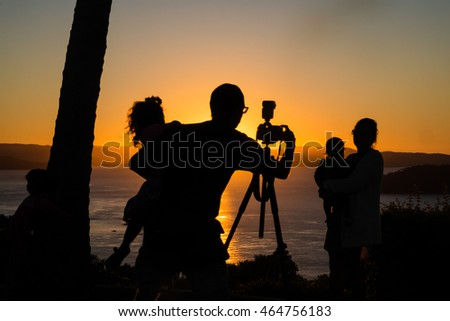 Family photo at sunset, in silhouette #464756183