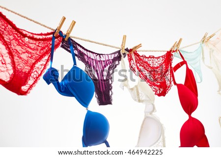 Female panties and bra drying on rope #464942225