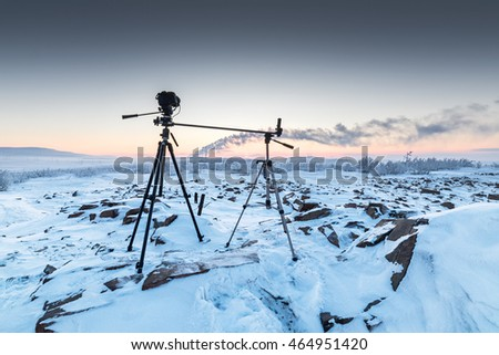 The camera on the two tripods during timelapse shooting. Arctic tundra, winter.