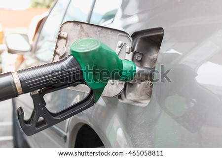 Grey car at gas station being filled with fuel on thailand #465058811
