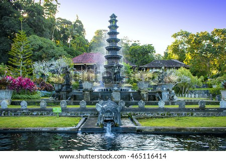 Fountain with pig statue in Tirtagangga Water Palace, Karangasem, Bali surrounded with beautiful green park #465116414