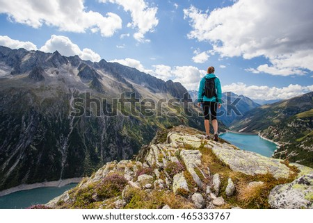 Woman hiker on a top of a mountain during hiking track in Austria #465333767