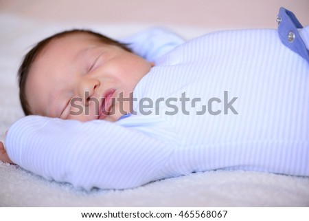 After childbirth newborn baby sleeping in a bed with a diaper #465568067