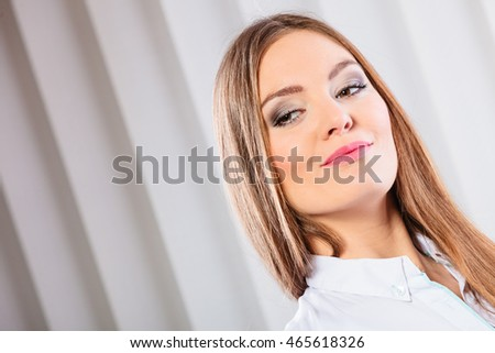 Career business work in office formal wear. Young woman worker present stand with confidence smiling. #465618326