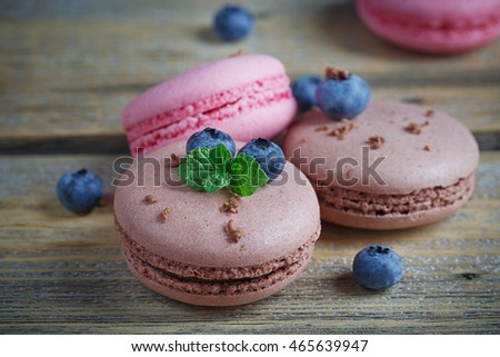Macaroon with fresh blueberries and chocolate on rustic wooden background #465639947