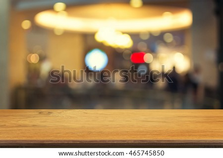Empty wooden table and blurred Coffee shop interior background with bokeh image, for product display montage,can be used for montage or display your products. #465745850