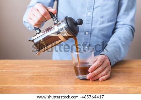 brewing coffee siphon. step by step cooking instructions. barista pours coffee from a french press in the cup #465764417