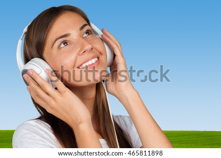 Portrait of a beautiful woman student  listening to music #465811898