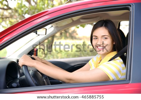 Woman strapped with safety belt in car #465885755