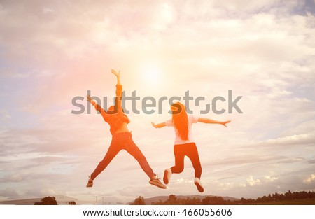 silhouette of a happy human and happy time sunset (Soft focus) #466055606