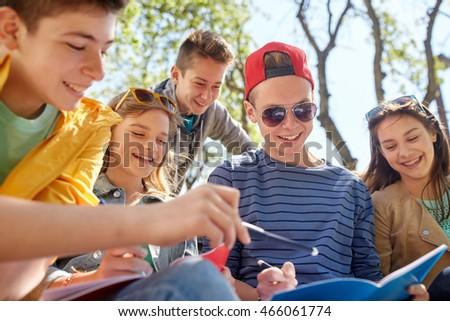 education, high school and people concept - group of happy teenage students with notebooks learning at campus yard #466061774