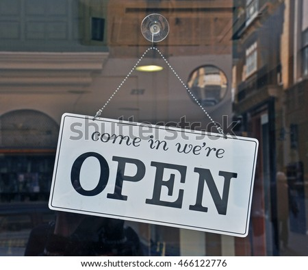 Black and white open sign hanging on the door #466122776
